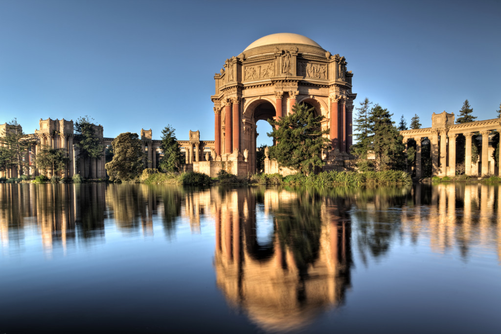 The Palace of Fine Arts in San Francisco, California at sunrise. The Palace of Fine Arts was built in 1915 for the Panama-Pacific Exposition, today we know it as the Worlds Fair. The domed structure was named the Tower of Jewels. The PoFA is currrently undergoing renovation so the onlt access is from the pond. Not sure how long the renovation will take as we left before the Exploratorium open.