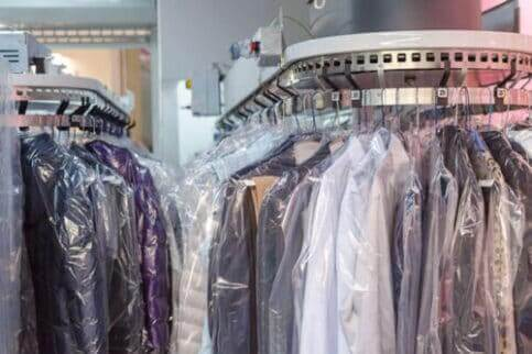 Wayzata Pennhurst DryCleaning, Laundry & Garment Experts eco-friendly dry cleaning rack with hanging clothes