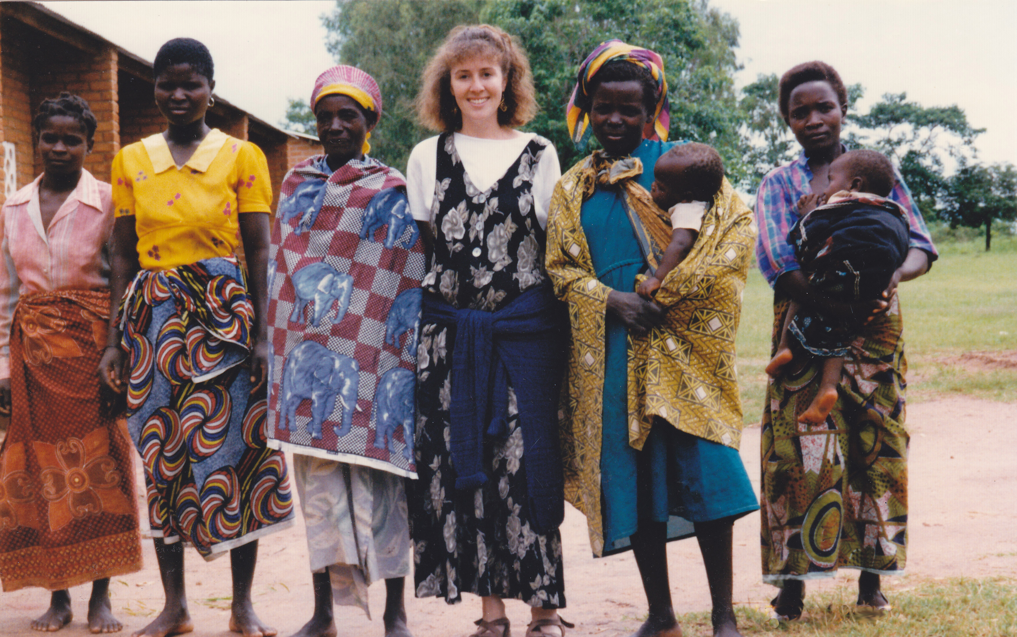 Author Shana Burg with villagers in Malawi photo