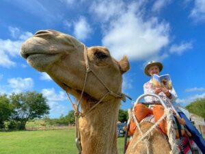 Kathi Appelt on a camel