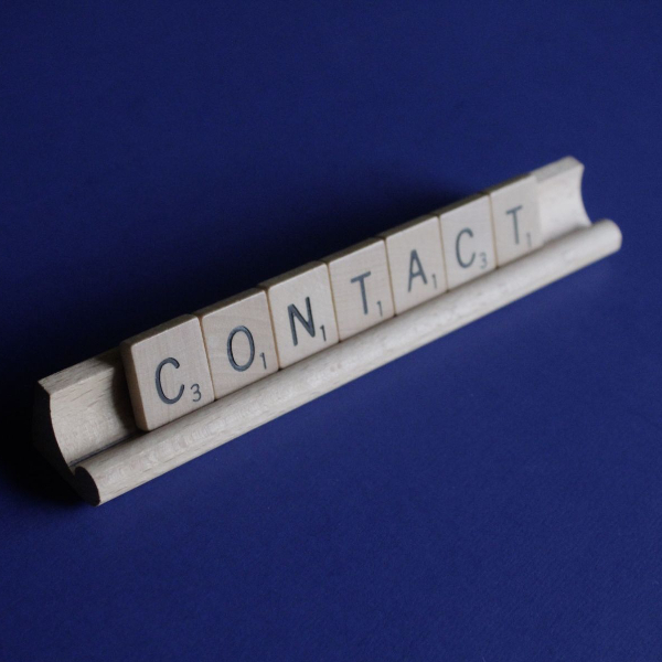 Scrabble letters that spell contact