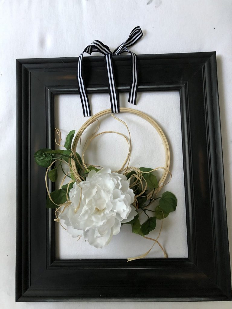 Farmhouse wreath on the embroidery hoop with white  flower and raffia framed