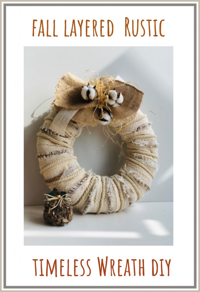 Beautiful fall layered rustic wreath with simple burlap, raffia and ribbon bow.