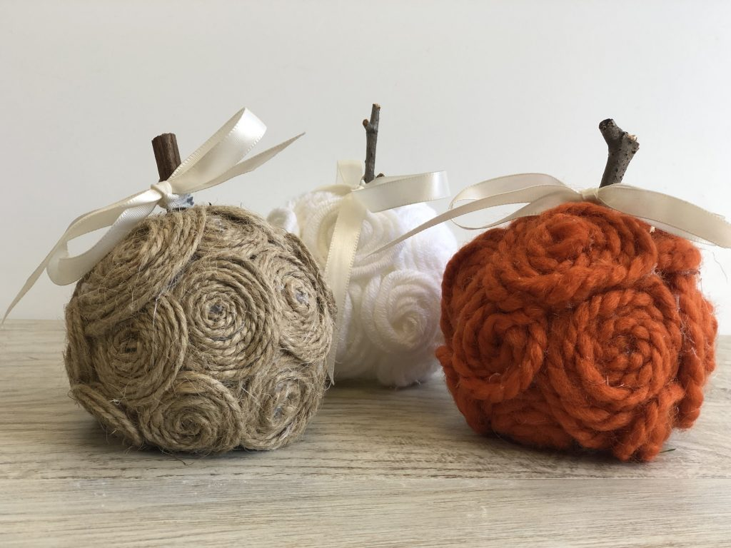 Stunning elegant white ,tan and orange mini pumpkins made out of twine.Elegant, easy & sofisticated fall yarn pumpkin DIY with satin bow is the one you need to have this fall in your house. yarn pumpkin.Budget friendly fall decor idea