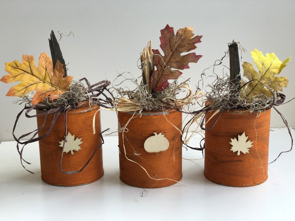 Turn your recycle into one nice fall home decor! Turn your tin cans into a rustic fall show stopperBudget friendly fall decor ideas. Fall pumpkin craft. Can upscycle craft diy. Dollar Tree crafts. Easy pumpkin