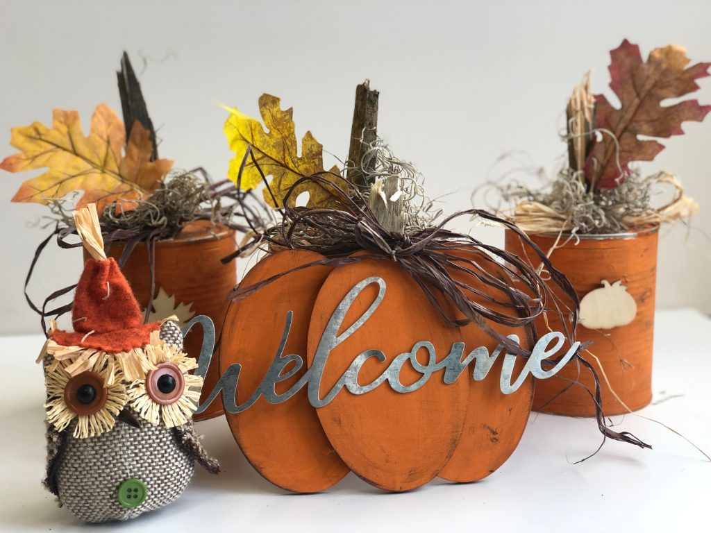 Turn your recycle into one nice fall home decor! Turn your tin cans into a rustic fall show stopper! #thriftydecor #falldiy #falldecor #fall