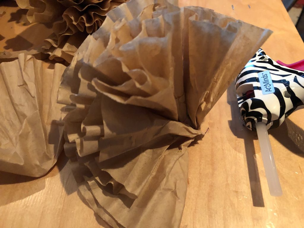 If you like texture,ruffles and easy home decor this fall project is for you. Coffee filters wreath. Easy fold bow diy