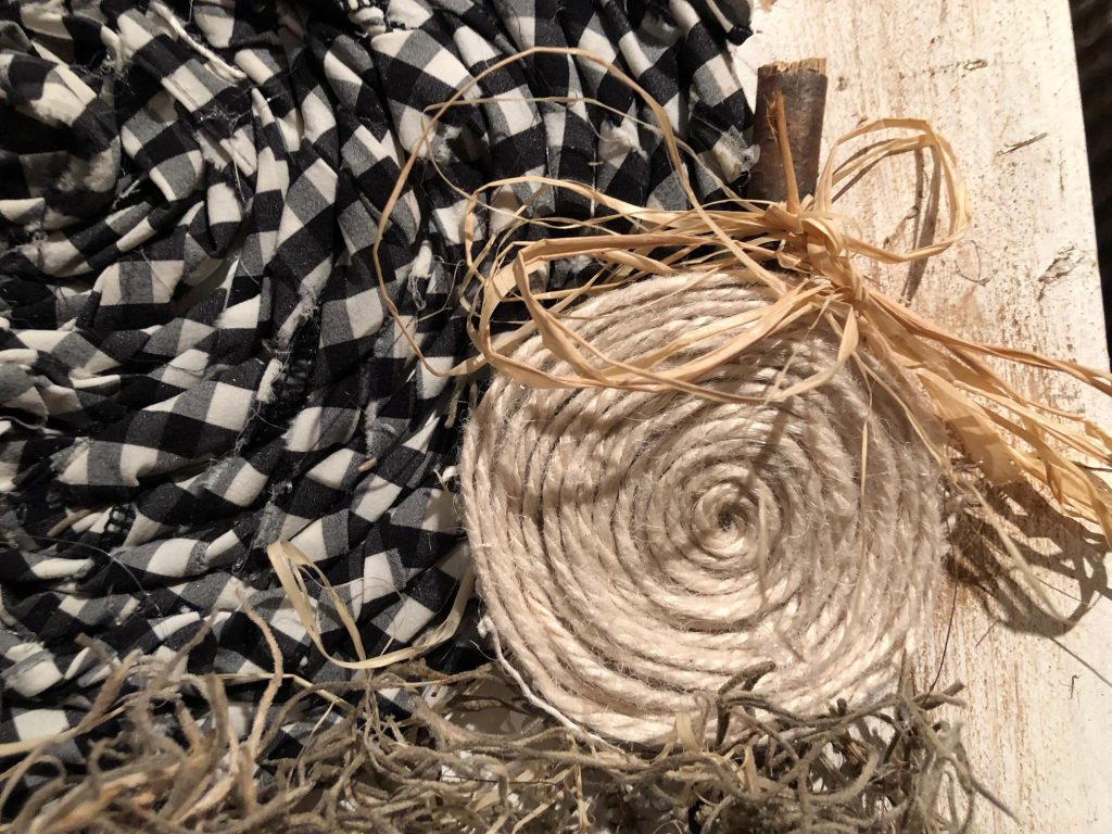 Buffalo check fabric pumpkin on the wooden board. Easy fall tutorial. Easy bow tutorialBuffalo check fabric pumpkin on the wooden board. Easy fall tutorial.Learn how to put your fabric pieces into one fun and elegant Fall decor idea! Fabric pumpkin diy. Drop cloth pumpkin  Yarn pumpkin diy
