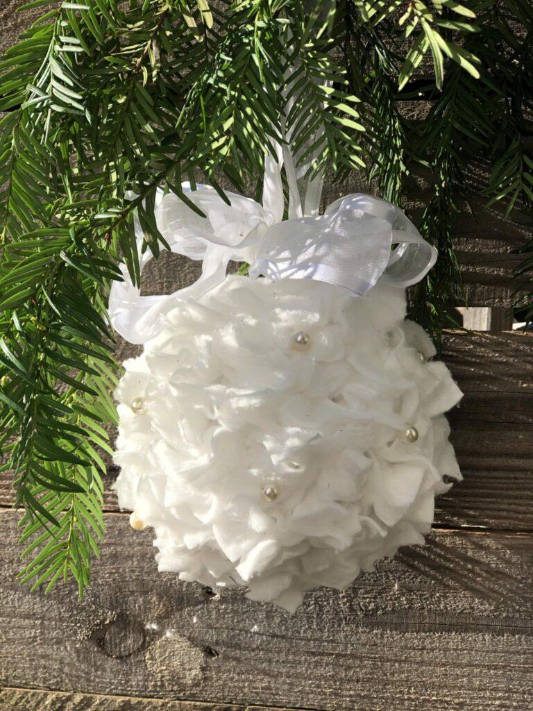 White Christmas ornament diy with satin bow.EASY Christmas ornament. Elegant ornament Dollar Tree budget friendly Christmas decor idea DIY. CHRISMTAS DECOR on the budget . Gift idea