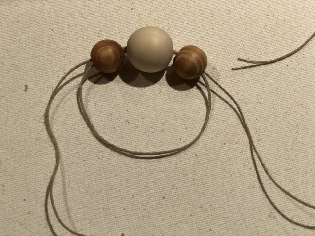 Three wooden beads to make napkin ring.