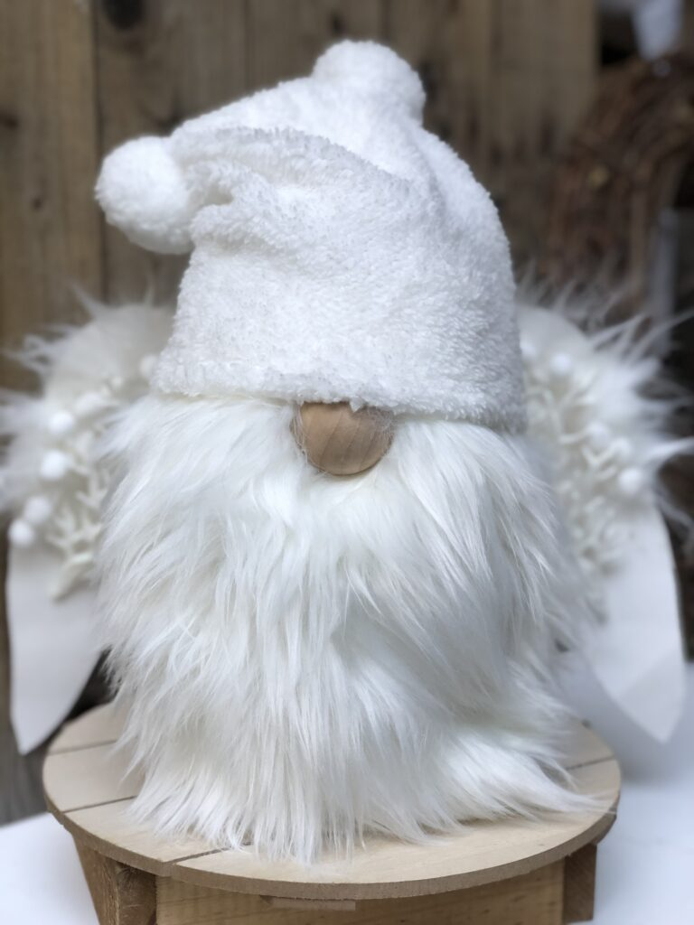Learn how to make a easy Gnome. Christmas Snow White Gnome DIY. Perfect budget friendly way to decorate your house this holiday season. Dollar Tree hat
