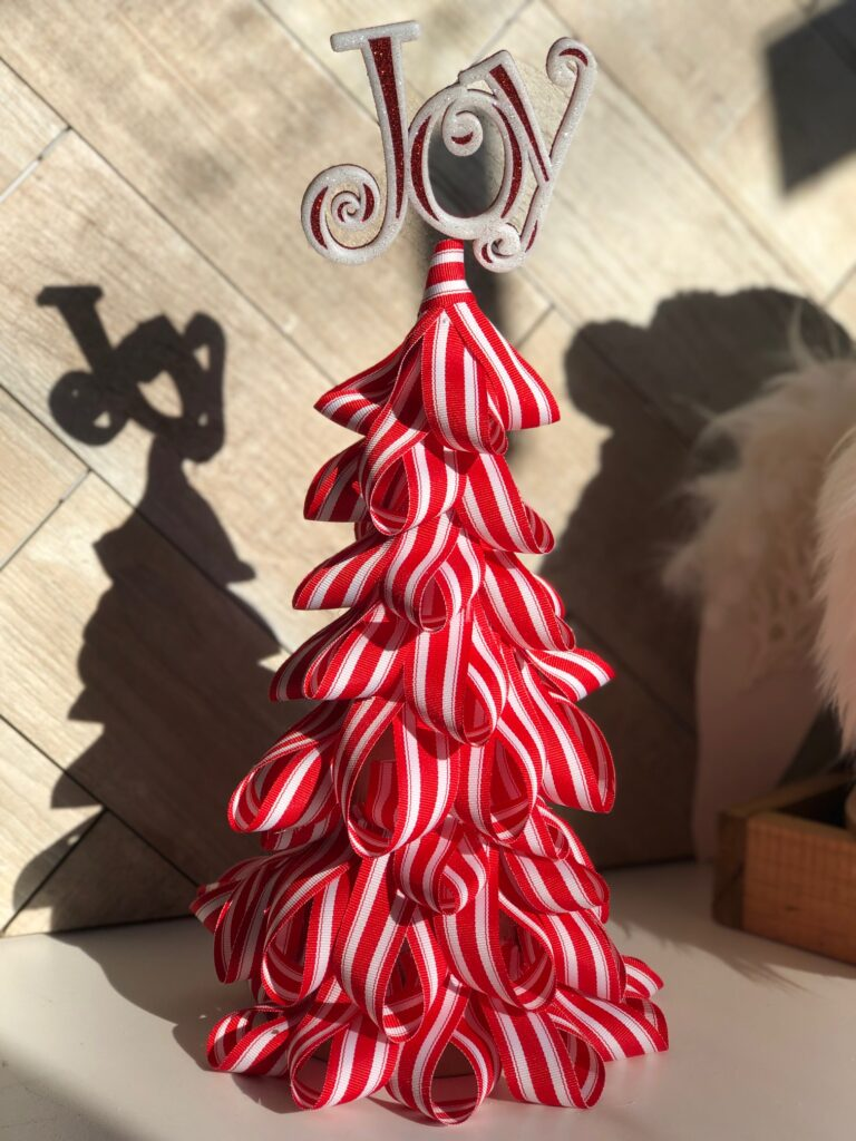 Learn how to make Candy Cane Christmas Tree. Super easy directions. Christmas craft DIY. Ribbon holiday craft