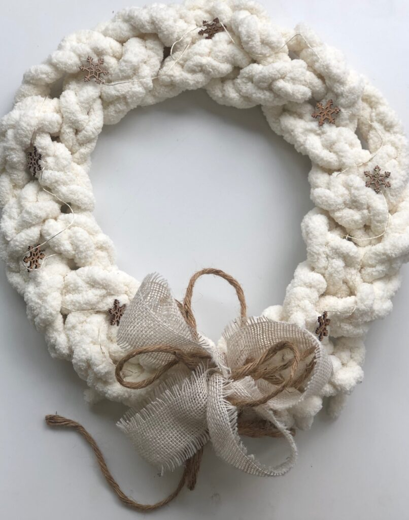 Learn how to make Braided Chunky Yarn White Christmas wreath. Easy simple Folded Bow.