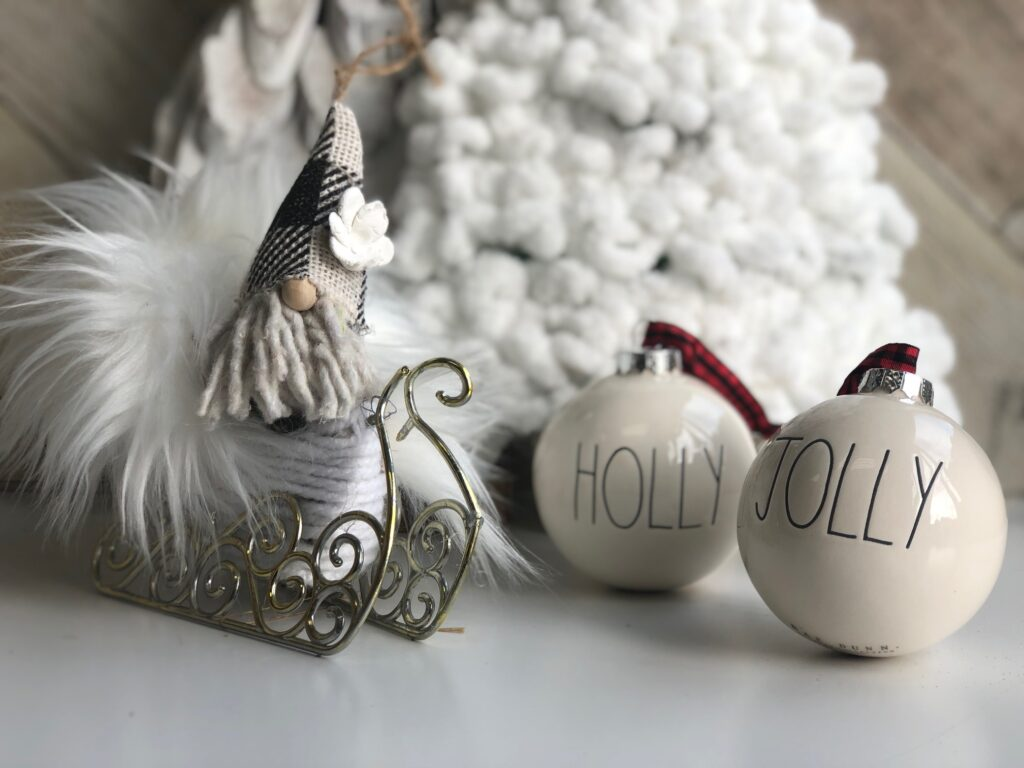 Learn how to turn inexpensive Dollar Tree merchandise into upscale Christmas decor!  White chunky yarn Christmas tree diy. Rae Dunn ornaments. Dollar Tree Santa Sleigh
