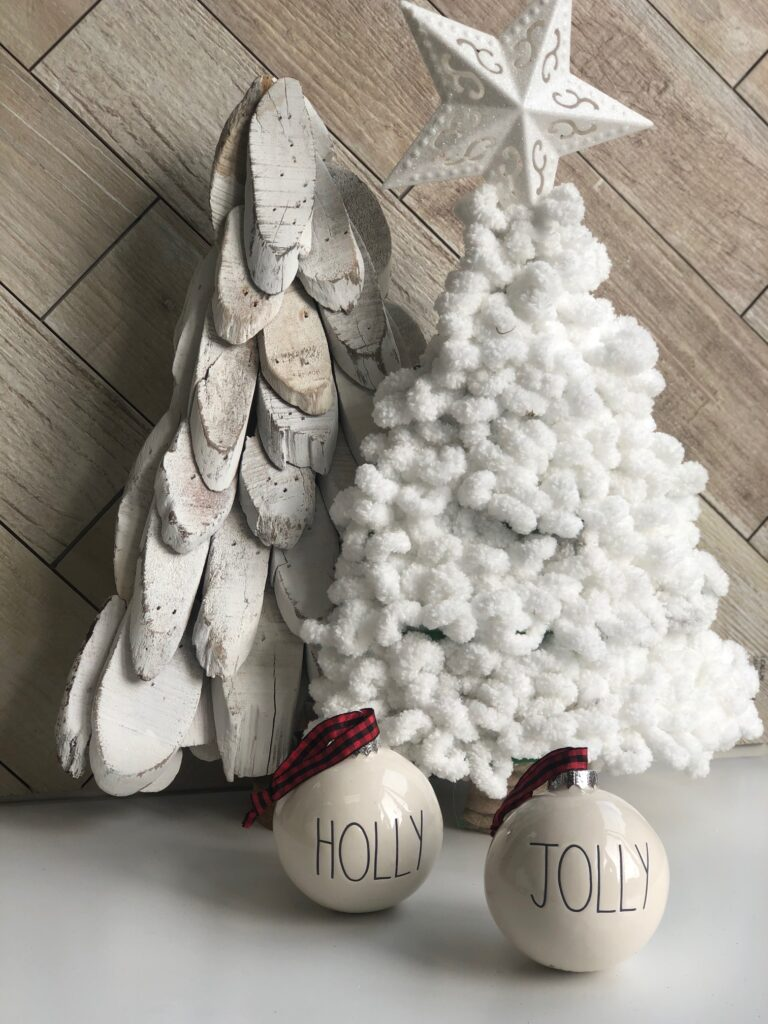Learn how to turn inexpensive Dollar Tree merchandise into upscale Christmas decor!  White chunky yarn Christmas tree diy. Rae Dunn ornaments