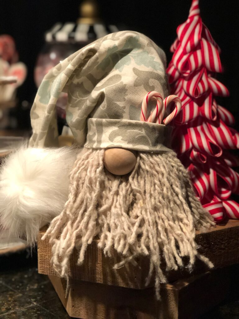 Christmas Gnome made out of Dollar tree mop. Hot Cocoa Bar display. Dollar Tree hot cocoa bar