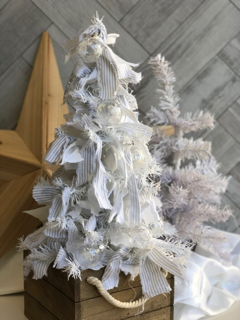 Rag Christmas tree with white and grey accents. Bulb Christmas lights. Super easy DIY. Dollar Tree craft