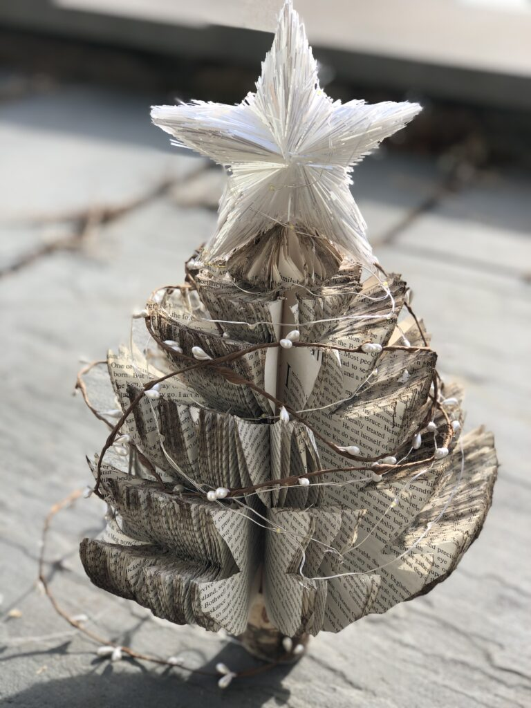 Learn how to make book pages Christmas tree out of book pages. Stunning Budget friendly Christmas project. Dollar tree craft