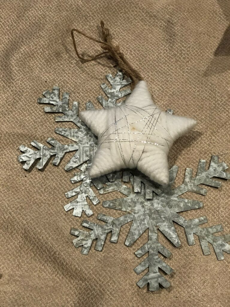 Galvanized snowflake with easy star to decorate Candy Cane Christmas Wreath