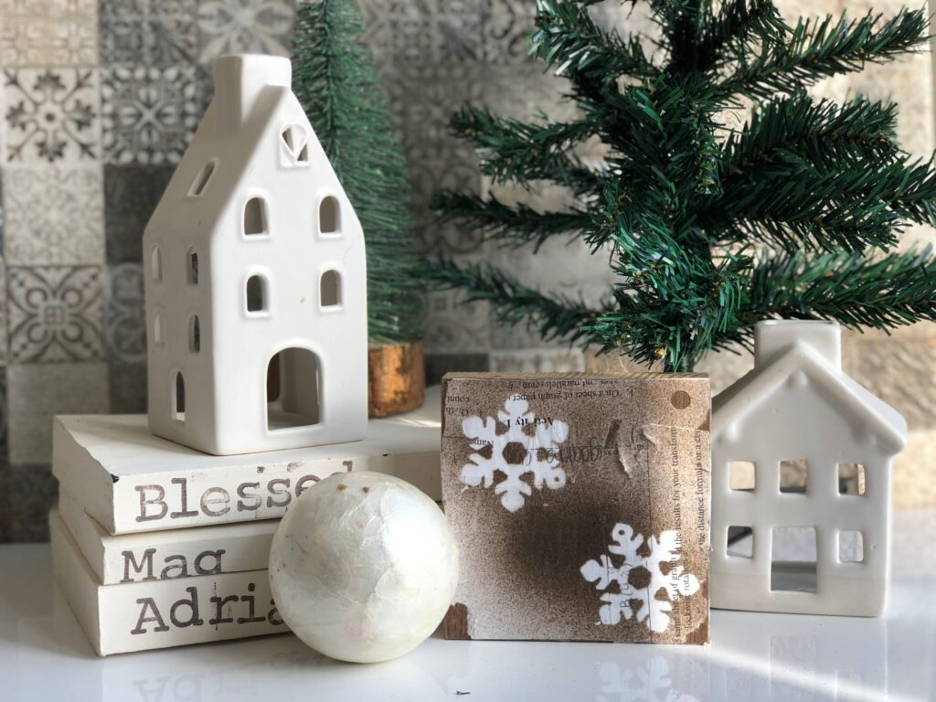 Winter decor for me is all about snowflakes. It is time to make some with vintage farmhouse touch. Super fun on the dollar tree budget diy. Stacked books diy