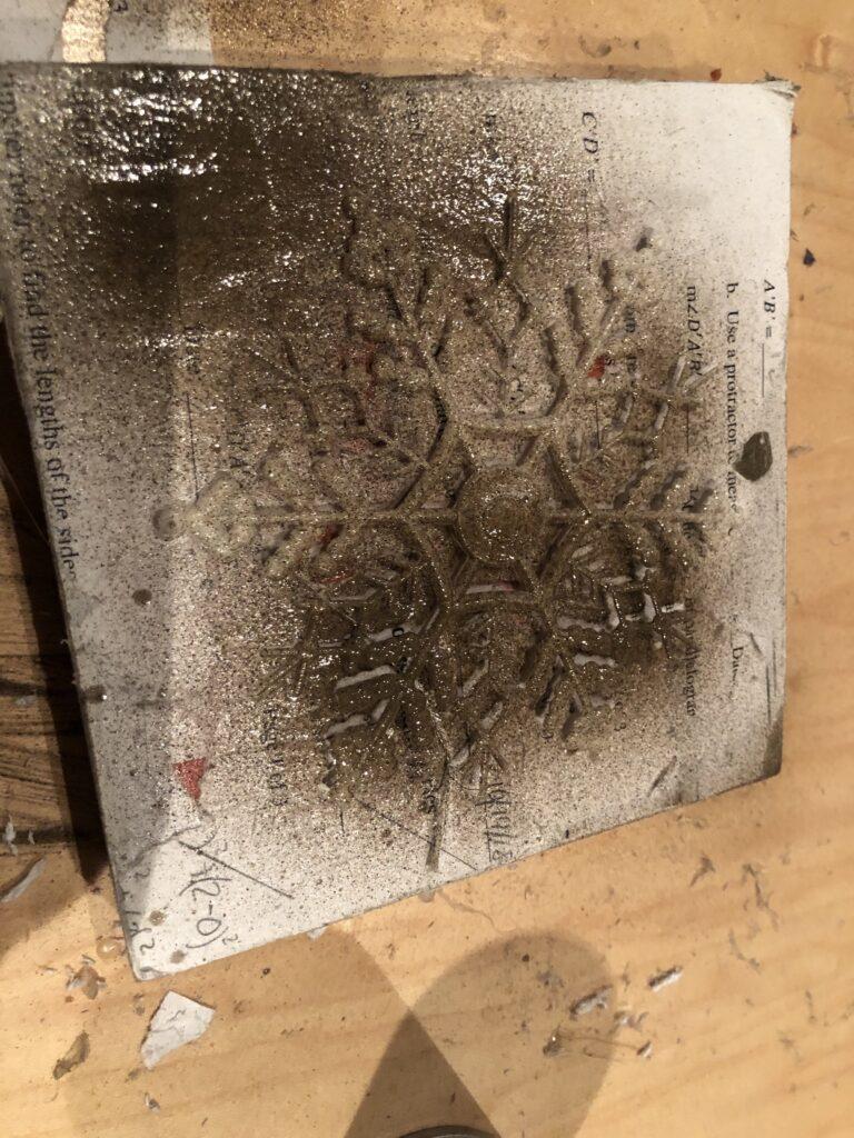 Snowflake spray painted on the wood block .Farmhouse snowflake star DIY. Dollar Tree craft