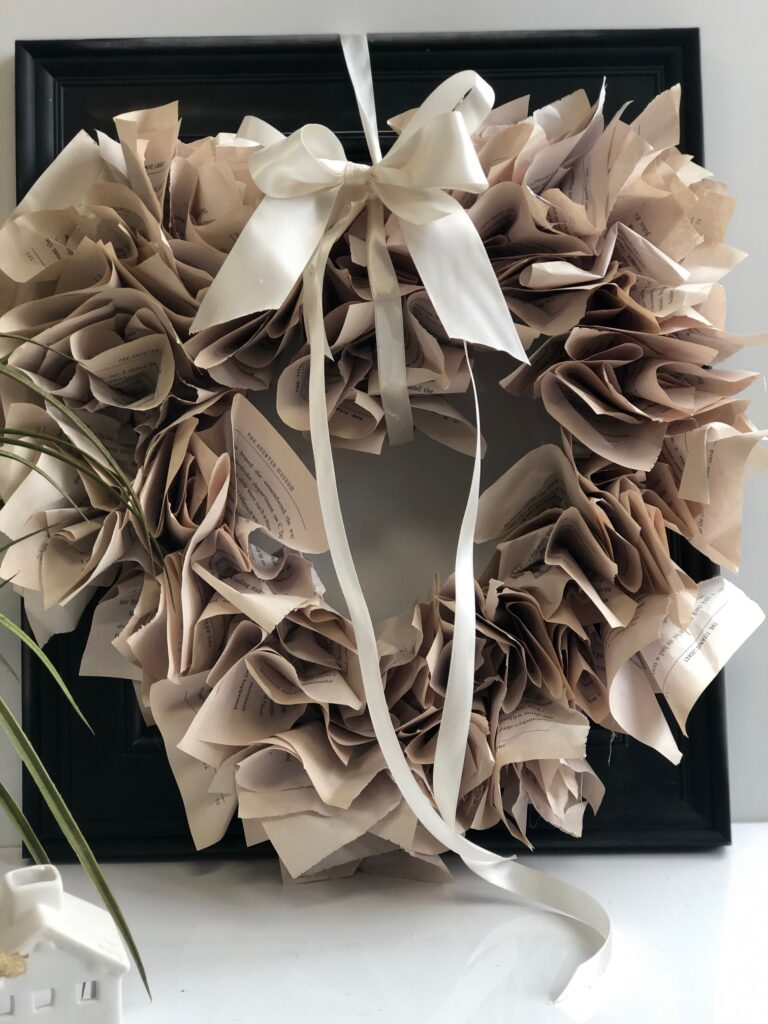 Shabby and Chic Romantic Heart Shaped Framed Wreath DIY. Beautiful budget friendly Wreath perfect for Valentines Day. Year round Wreath diy. Dollar Tree wreath DIY. Book page wreath