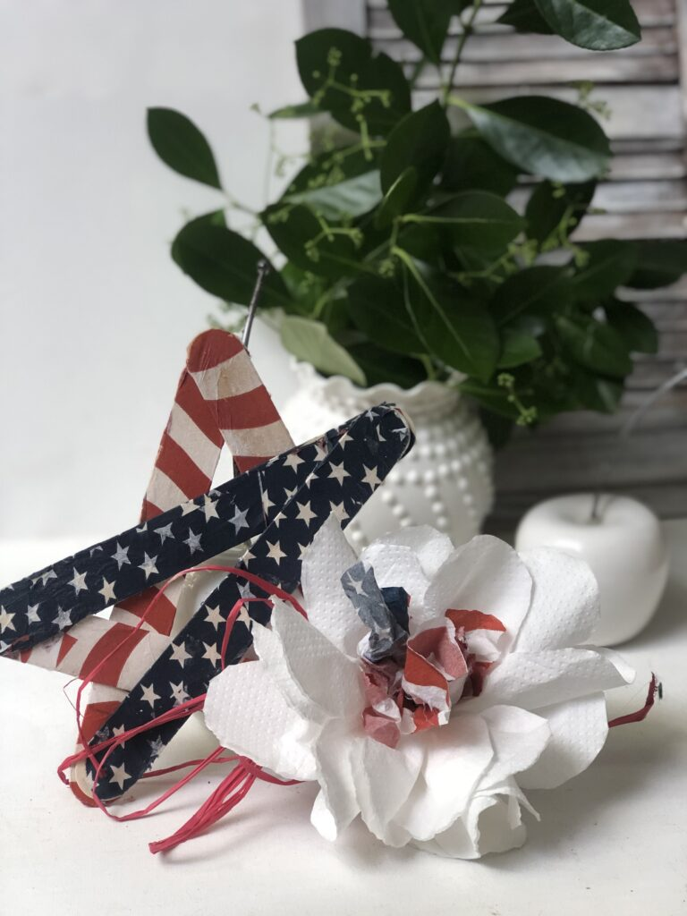 Red White & Blue Star Banner. July 4th craft budget friendly patriotic project to decorate your house or backyard! Paint stir sticks patriotic craft idea.