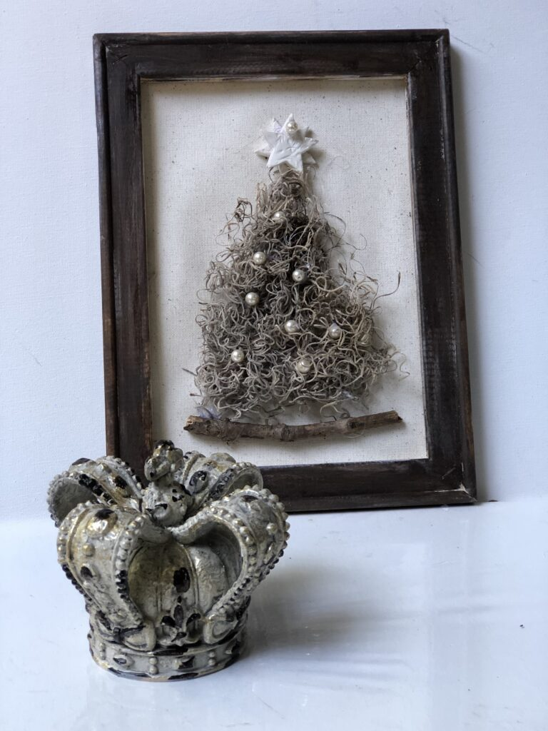 Learrn how to make Whimsical Moss Christmas tree DIY. Reverse Canvas Christmas tree home decor craft. Rustic Christmas tree DIY