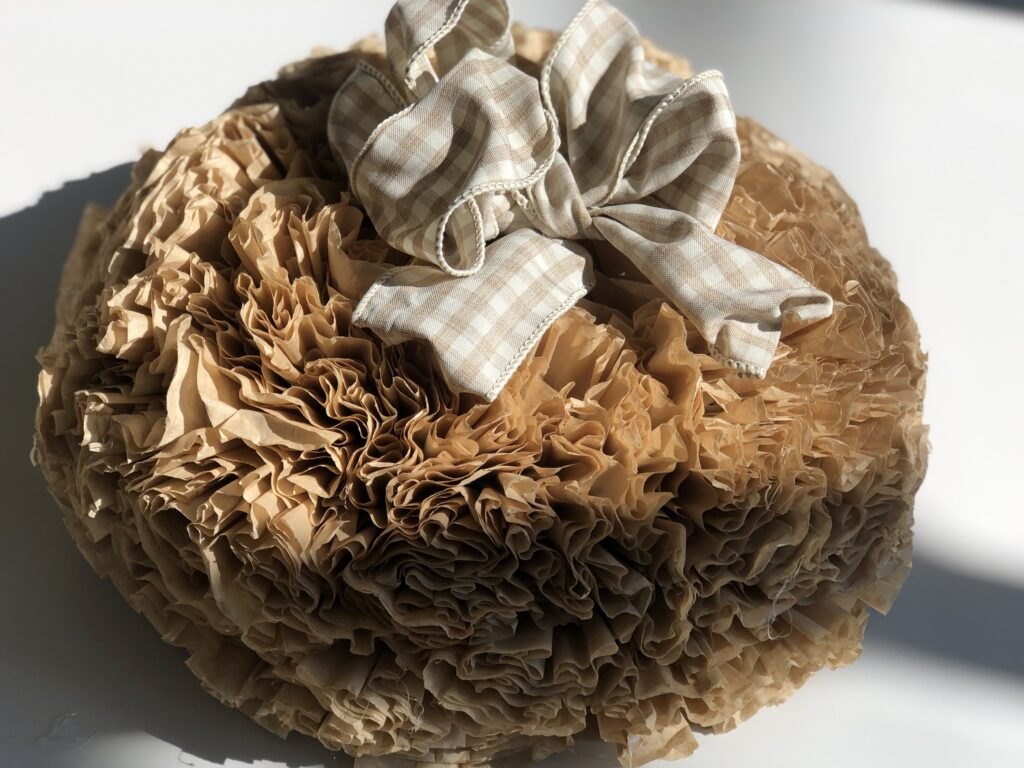 If you like texture ruffles and easy home decor this fall project is for you. Coffee filters wreath. Easy fold bow diy .Budget friendly fall decor idea