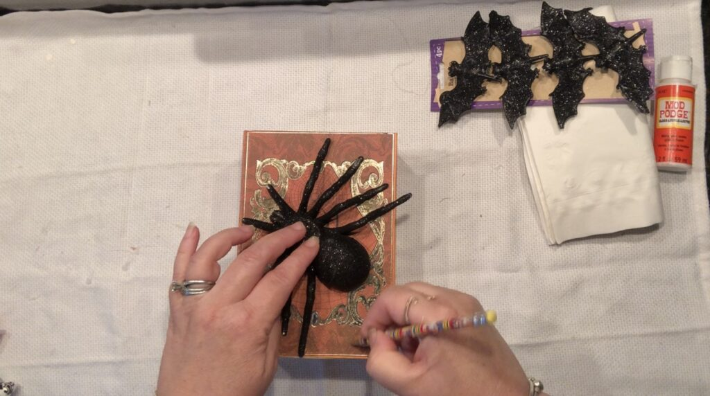 Put your Dollar Tree merchandise to use and transform it to one spooky Halloween decor! Spell Book diy