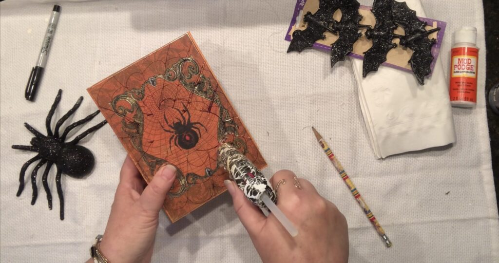 Put your Dollar Tree merchandise to use and transform it to one spooky Halloween decor! Spell Book diy. Easy Halloween decor diy