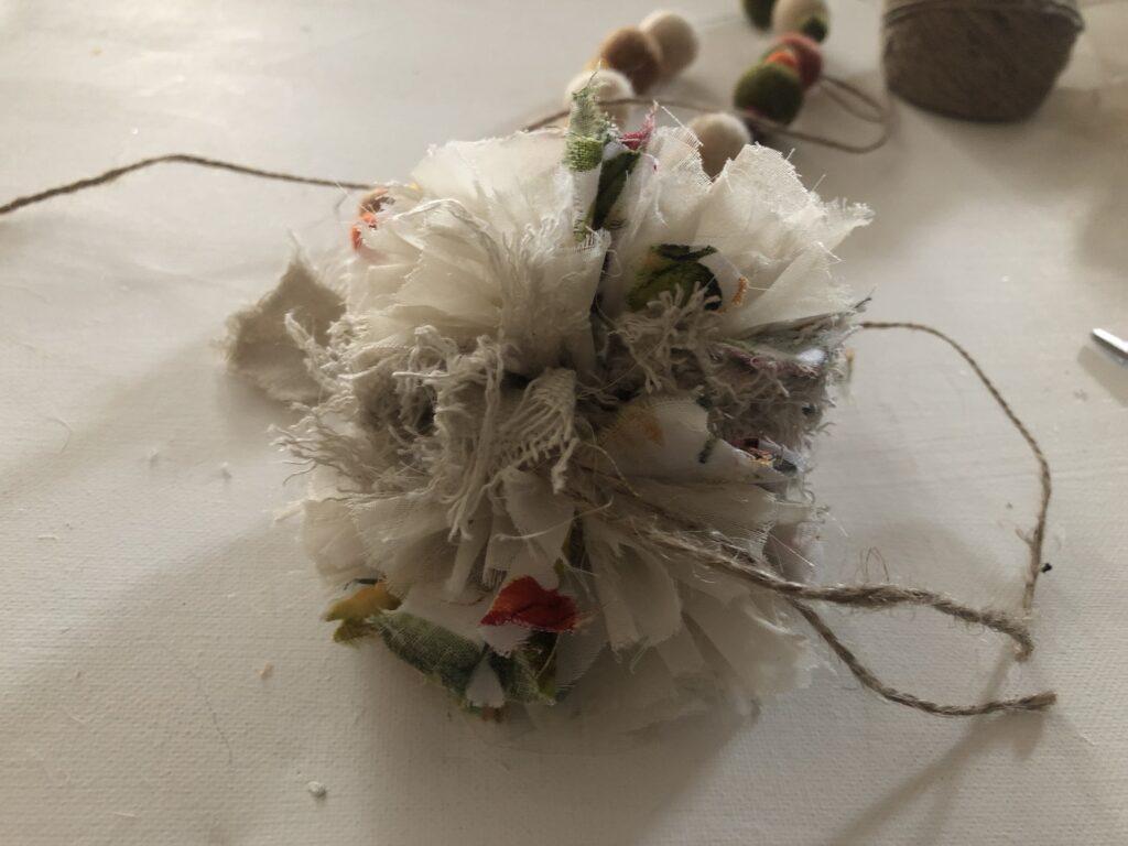 how to make fabric rag Pom Pom Easy Elegant fall felt garland with fabric Rag Pom Pom DIY. Fun way to decorate for the holidays. Felt balls fall craft. Mantel decor diy