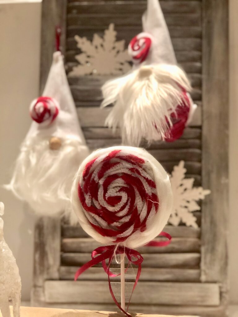 Candy cane ornaments gnome bring some much Christmas joy to any decor.Make this stunning Candy Cane Christmas tree out of ribbon. Budget friendly Christmas DIY. Ribbon Christmas tree craft.Dollar tree Christmas gnome craft Candy cane gnome