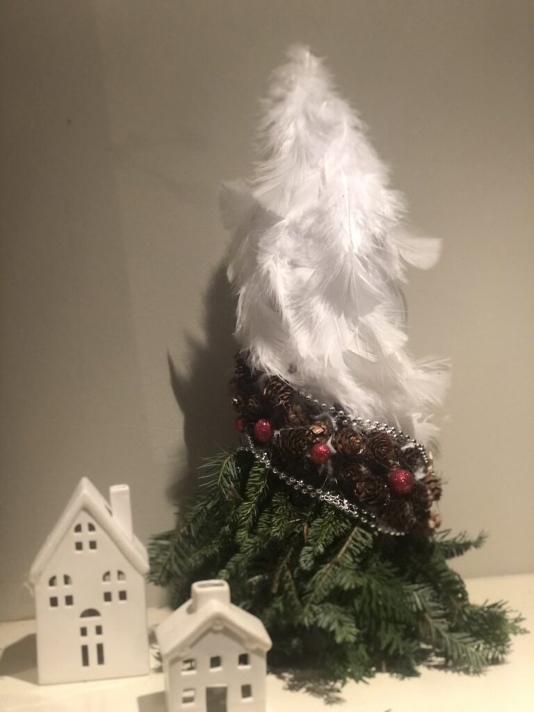 Let's make whimsical feather tree perfect for holiday decor. Holiday Chrismtas white feathers tree. Pine cone tree