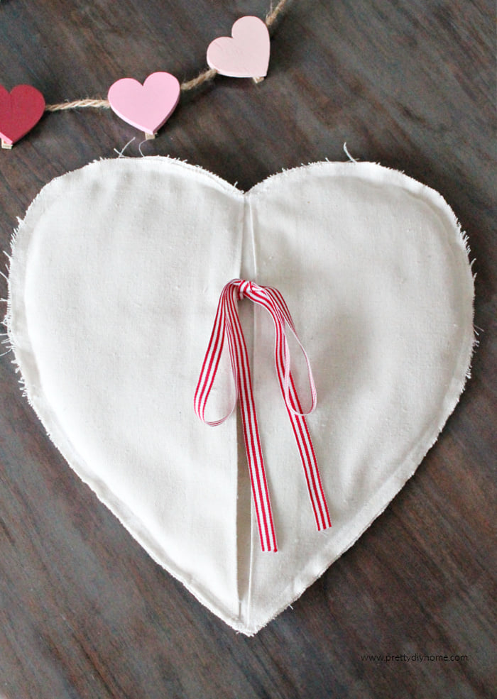 Make this simple DIY Farmhouse Valentine Heating pad using drop cloth for yourself or as a gift.