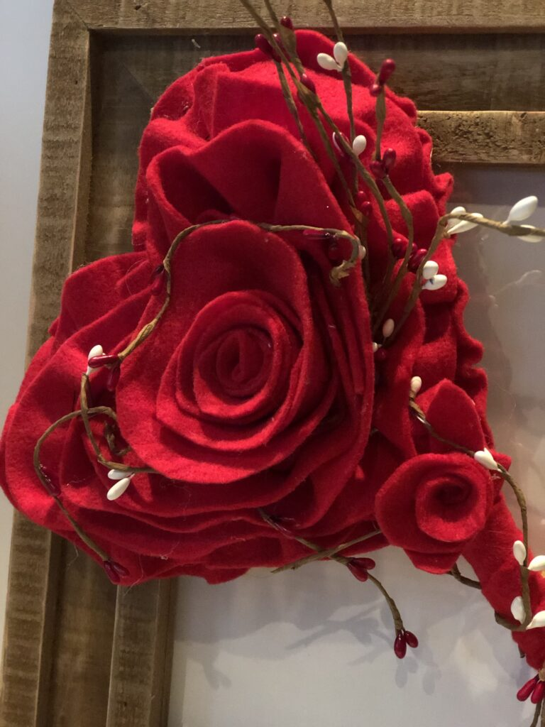 Holiday Valentines Day felt rose.Quick holiday wall picture makeover frame and bring some height to fireplace in style for Christmas. Valentine felt heart