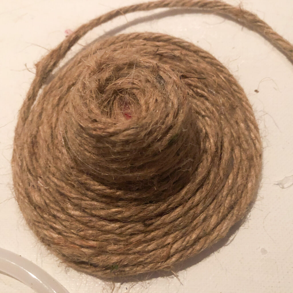 Learn how to make jute twine hat for your tiered tray. Perfect wreath embellishment. Easter Spring bonnet