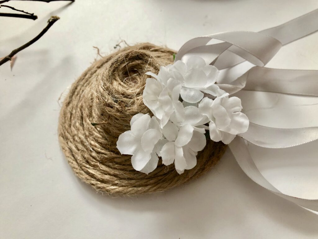 Decorate your door on the budget this Spring! Whimsical Easy to make Hat wreath. Jute twine hat diy. Evergreen Grapevine wreath