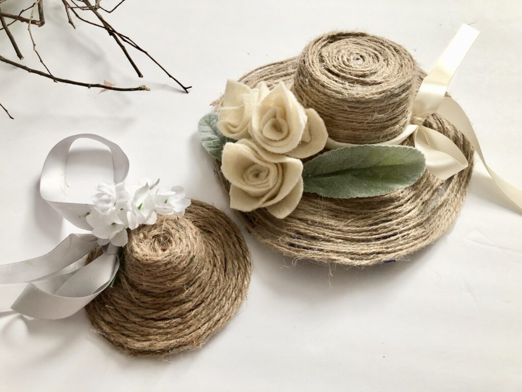 Decorate your door on the budget this Spring! Tiered tray accessory  Easy to make Hat wreath. Jute twine hat diy. Evergreen Grapevine wreath