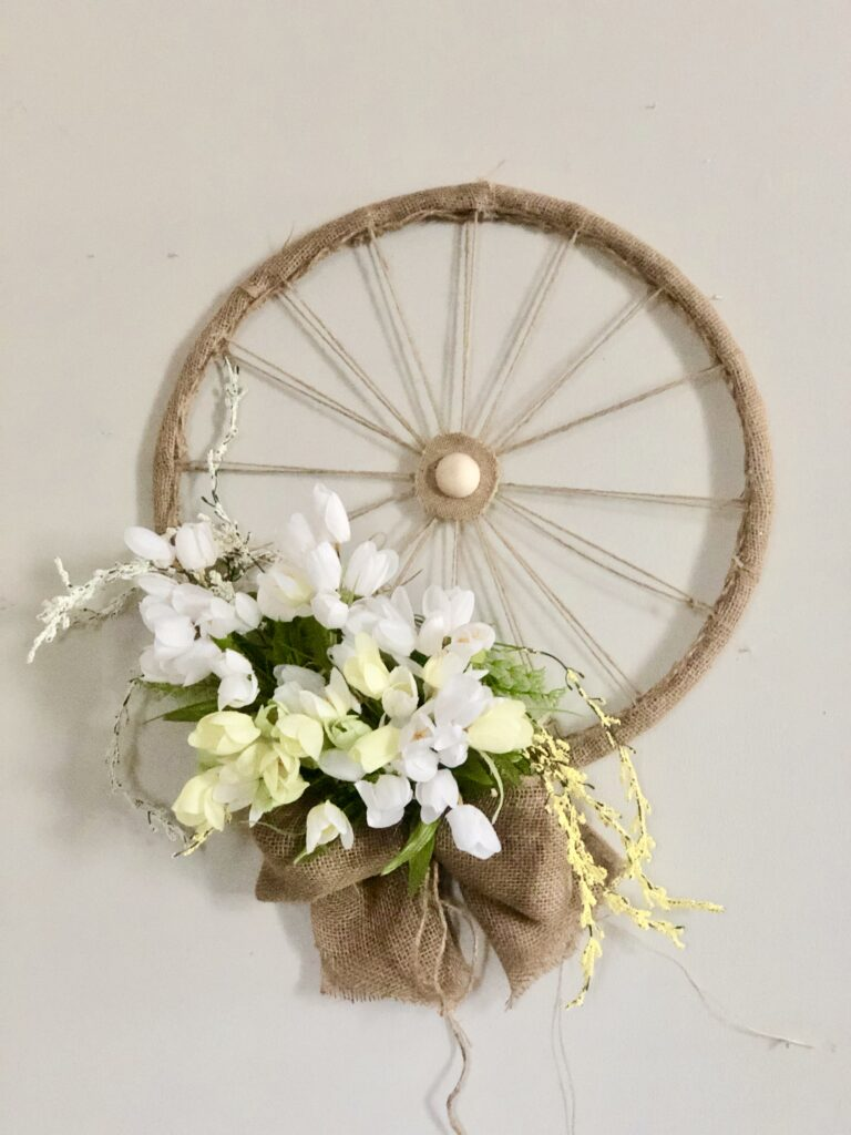 Learn how to make Spring Farmhouse style Wheel wreath on Dollar Tree budget. Easy spring to summer hula hoop wreath diy. Dollar tree spring hula hoop home decor idea