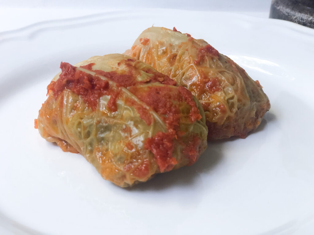 Learn how to make traditional polish stuffed cabbage the way my Mom taught me. Delicious easy to make cabbage dinner idea. Polish traditional dinner