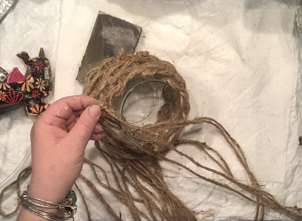 Learn how to transform a Dollar Tree glass vase to a stunning beauty. Learn how to weave with jute around glass vase. Boho home decor diy. Trash to treasure diy