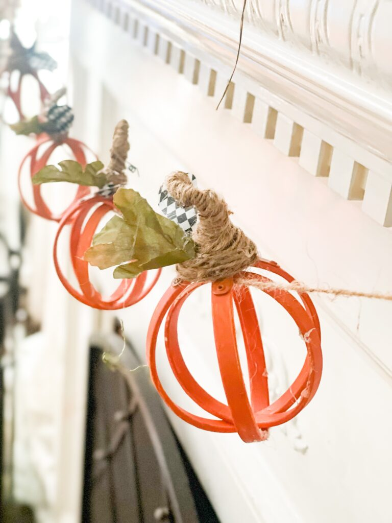 Let's make super cute lighted embroidery hoop fall pumpkin garland for your mantel. MacKenzie Childs inspired fall decor diy. Orb pumpkin garland with lights