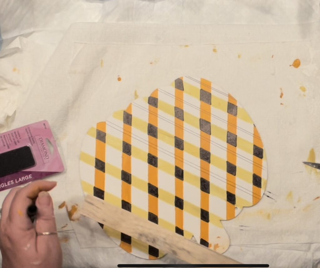 Learn how to paint buffalo check plaid pattern in the easy way. Fall candy corn buffalo check/ plaid pattern tutorial. Fun detail to fall decor diy