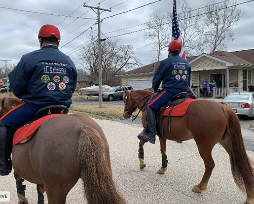 Veterans on horses in a parade