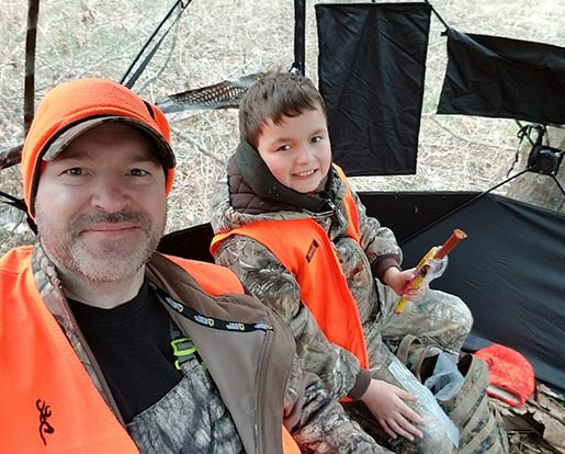 A father and son in hunting gear