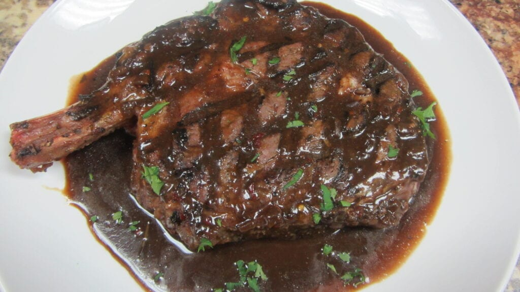 Bone In Ribeye with Wine Sauce