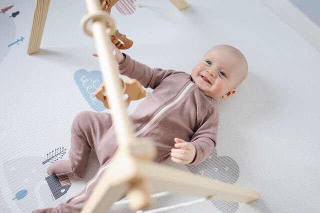 Baby lying down How to Buy Safe Toys as Gifts This Holiday Season