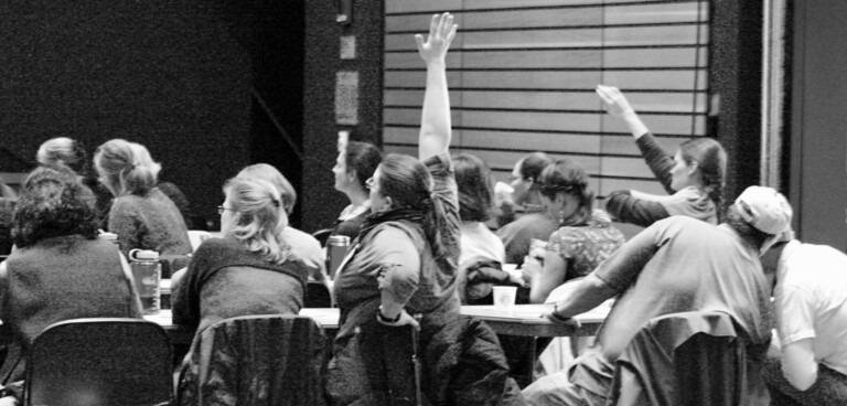 hands raised at teacher workshop