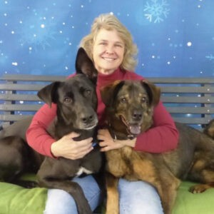 Cathy Hyland with her two dogs